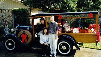 Gary's 1930 Model A Huckster with children Carrie, Lisa, and Jason, ready to deliver holiday presents.
